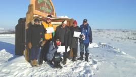 Group at  the Arctic Circle in Yukon